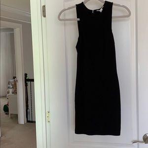 Sleek, black form fitting dress